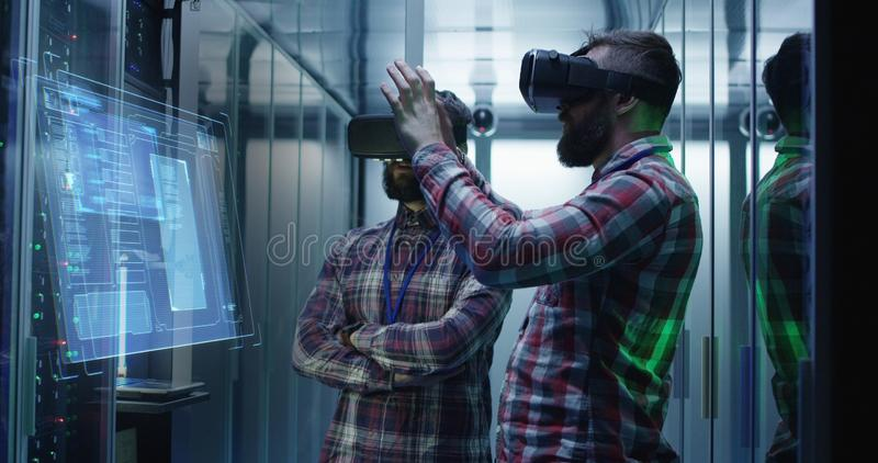 Two men working in a data center royalty free stock photo