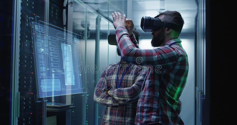 Two men working in a data center royalty free stock image