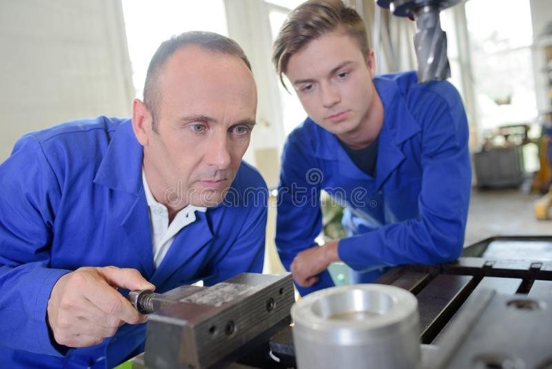 Two men in workshop stock image