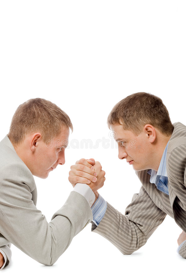 Two men wrestling with arms stock image