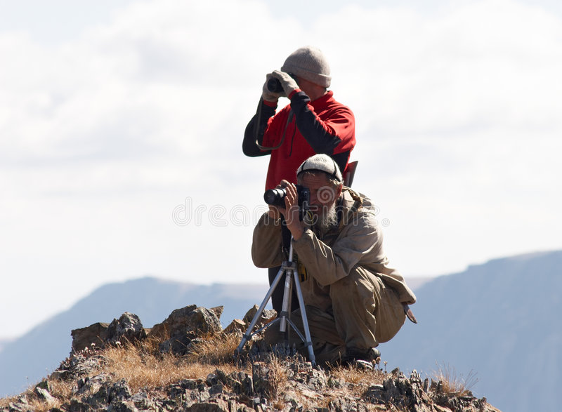 Two mens and mountains. stock photos