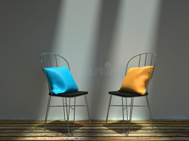 Two metal chairs with blue and yellow cushions royalty free stock photos
