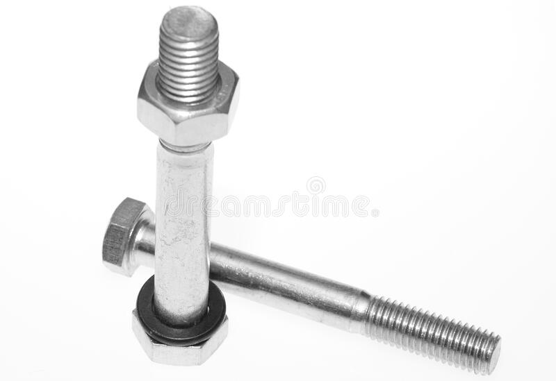 Two metal screws bolts one with nut and washer royalty free stock photos