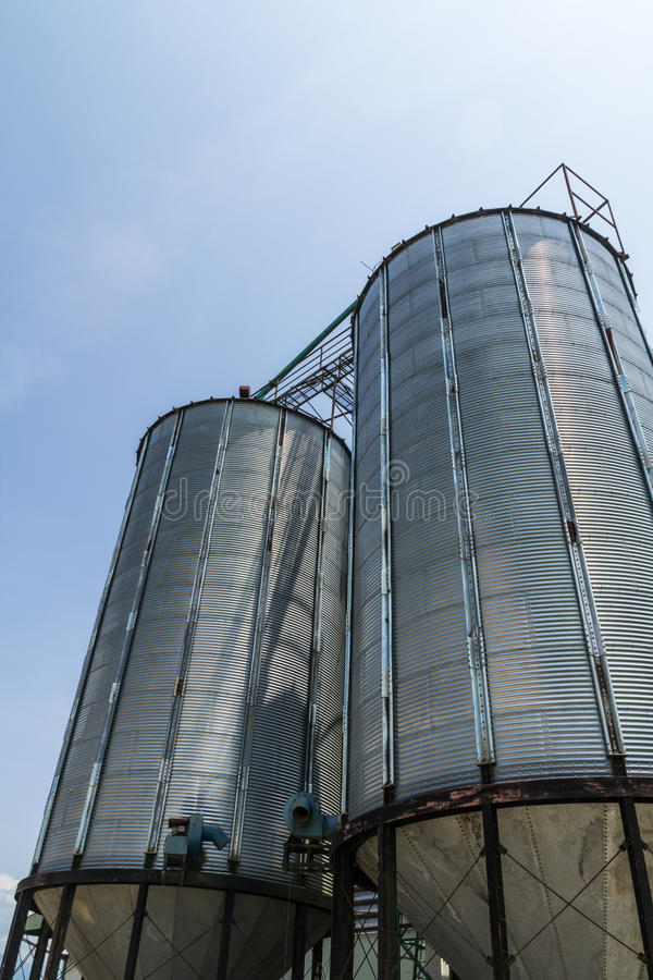 Two metal silo. Agriculure granary in Thailand royalty free stock photo