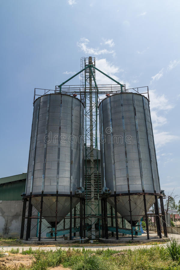 Two metal silo. Agriculure granary in Thailand stock image