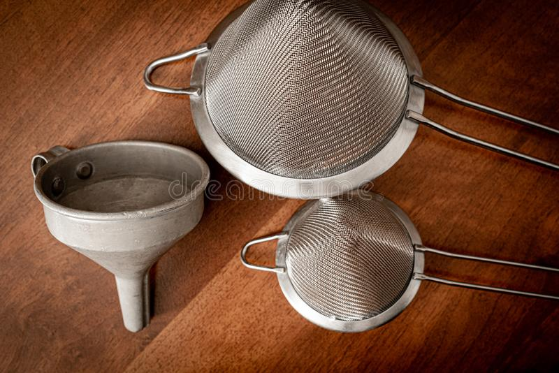 Two metal strainers and a metal funnel royalty free stock photo