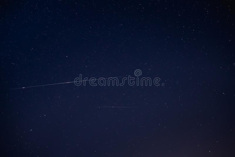 Two Meteoric Tracks In The Blue Night Starry Sky Background. Natural. Glowing Stars And Meteorites Trails royalty free stock photos
