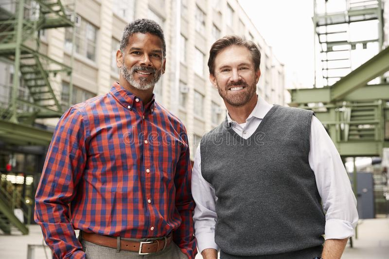 Two middle aged make colleagues outside their workplace royalty free stock photo