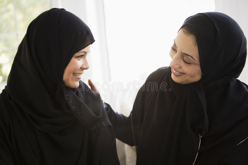 Two Middle Eastern women talking together.  royalty free stock image