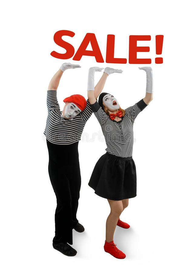 Two mimes posing on white stock photography