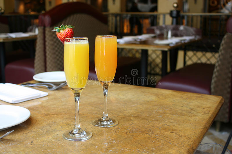 Two Mimosa Cocktails. Two mimosa cocktail glasses, lifestyle, horizontal stock images