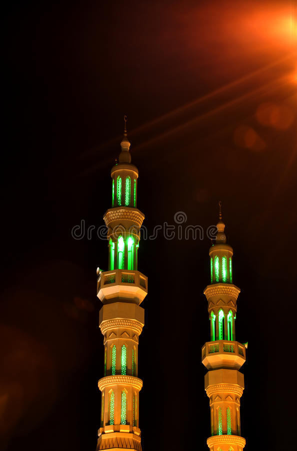 Two minarets in the night in United Arab Emirates royalty free stock photo