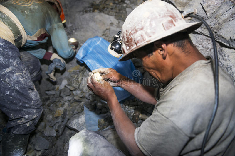 Two miners looking for silver in the silver mine of the Cerro Rico in Potosi, Bolivia. stock image