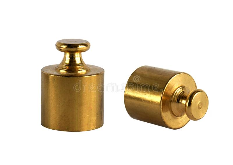 Two miniature bronze vintage weights stock photography