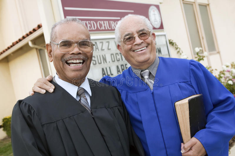 Two Ministers in Front of Church portrait royalty free stock photo