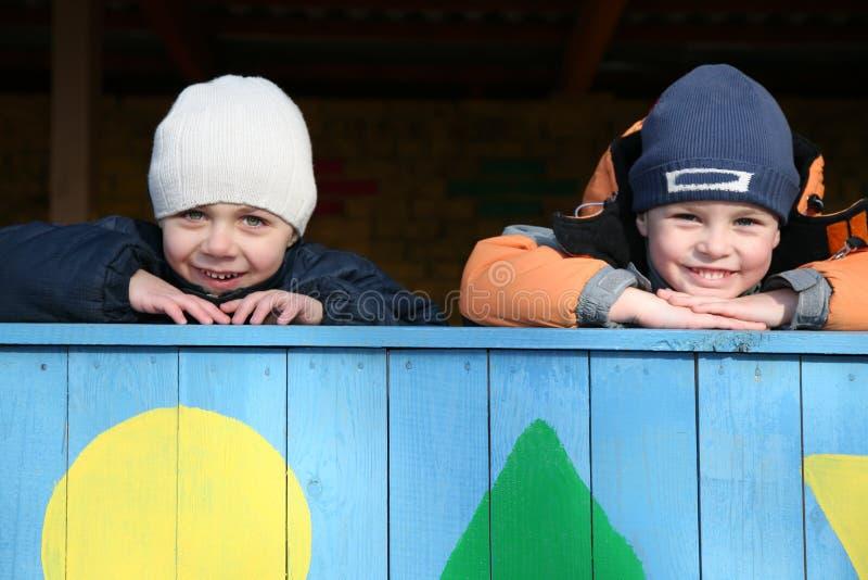 Two mischievous boys. In kindergarten royalty free stock photography