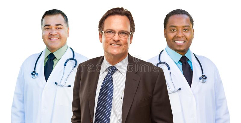 Two Mixed Race Doctors Behind Businessman Isolated on White. Two Mixed Race Doctors Behind Businessman Isolated on a White Background stock photos