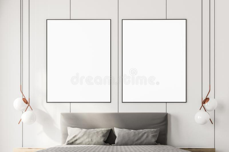 Two mock up posters above a king size bed. Two framed vertical posters hanging above a king size bed in a white luxury bedroom interior. 3d rendering mock up vector illustration