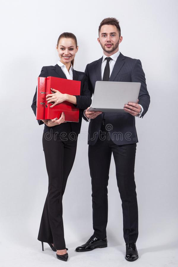 Two modern businessman standing on a white background with a lap royalty free stock image