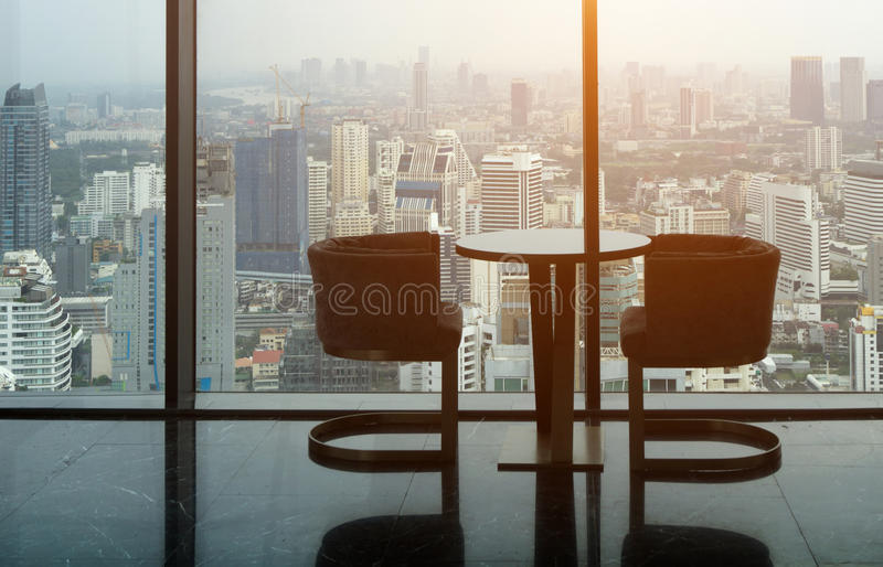 Two Modern Chair and circle glass table on tower office room wit royalty free stock images