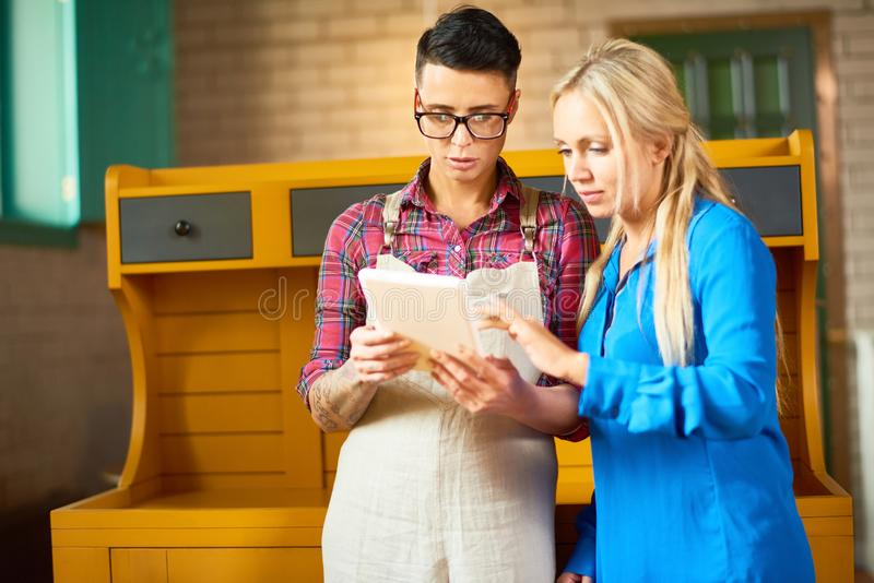 Two Modern Creative Women Discussing Work stock images