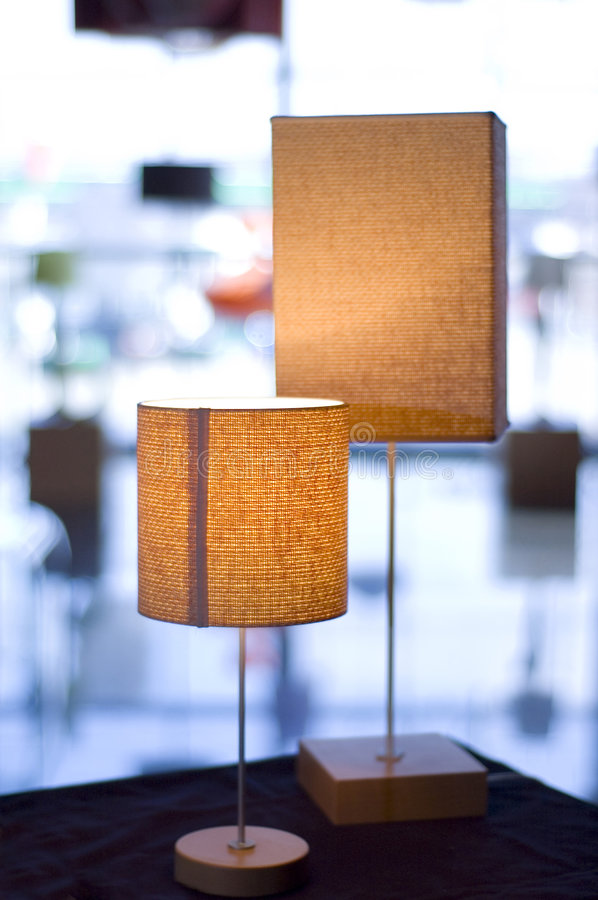 Two modern lit lamps stock photography