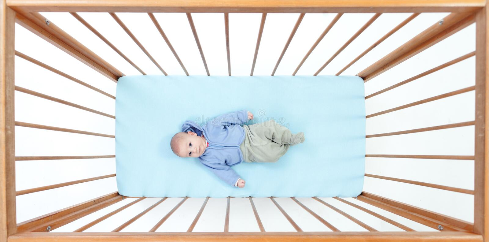 Download Two Months Baby Boy Lying In A Crib Stock Photo - Image: 16294682