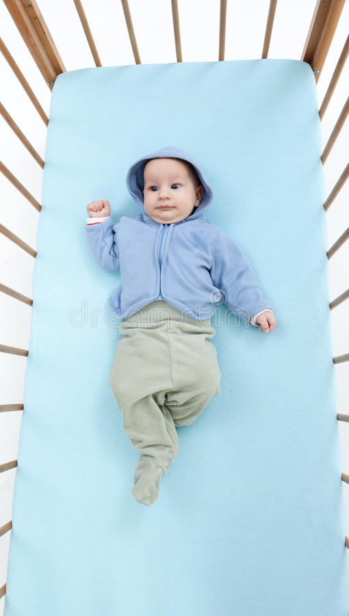 Two Months Baby Boy Lying In A Crib Royalty Free Stock Photo