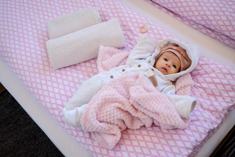 Two months old baby in the bed royalty free stock photos