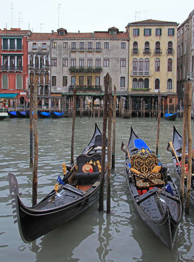 Two moored gondolas to the pier in Venice stock images