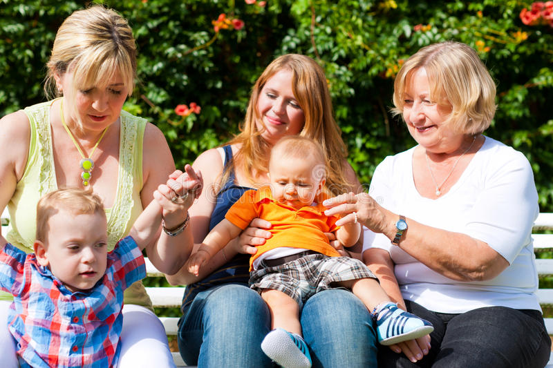 Download Two Mothers With Grandmother And Children In Park Stock Image - Image: 23332211