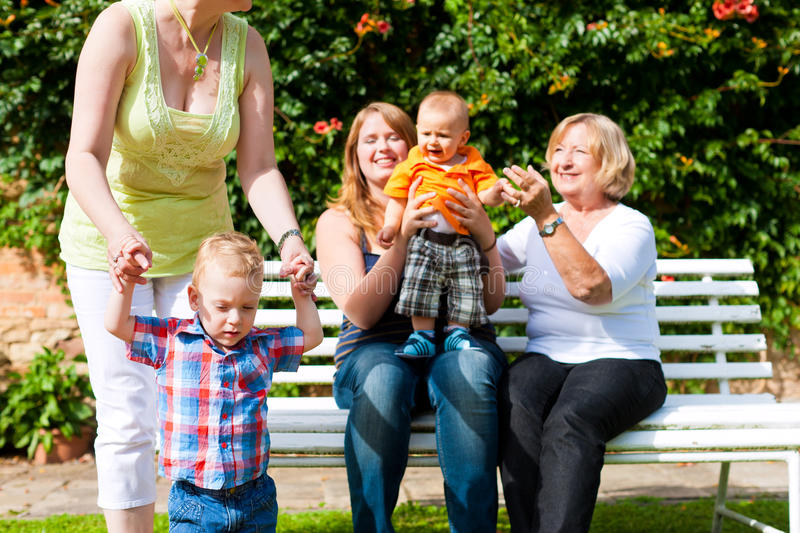 Download Two Mothers With Grandmother And Children In Park Stock Image - Image: 23332225
