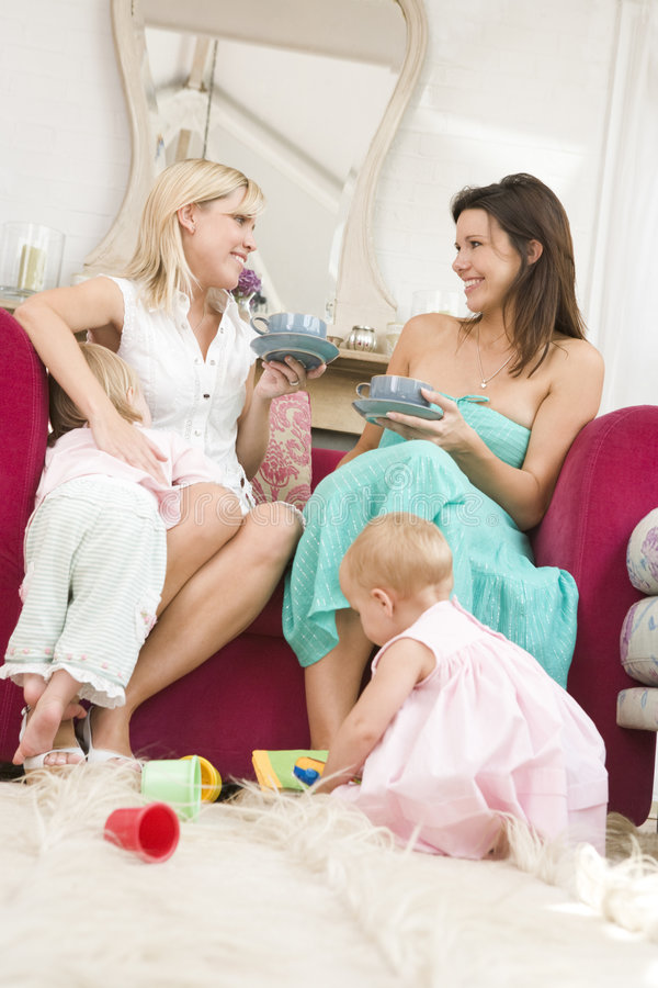 Download Two Mothers In Living Room With Babies And Coffee Stock Photo - Image: 5939700