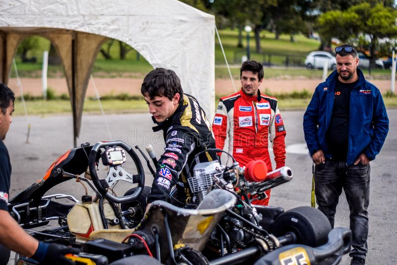Two Motorcycle Racers Standing in Front of Motorcycles stock photos
