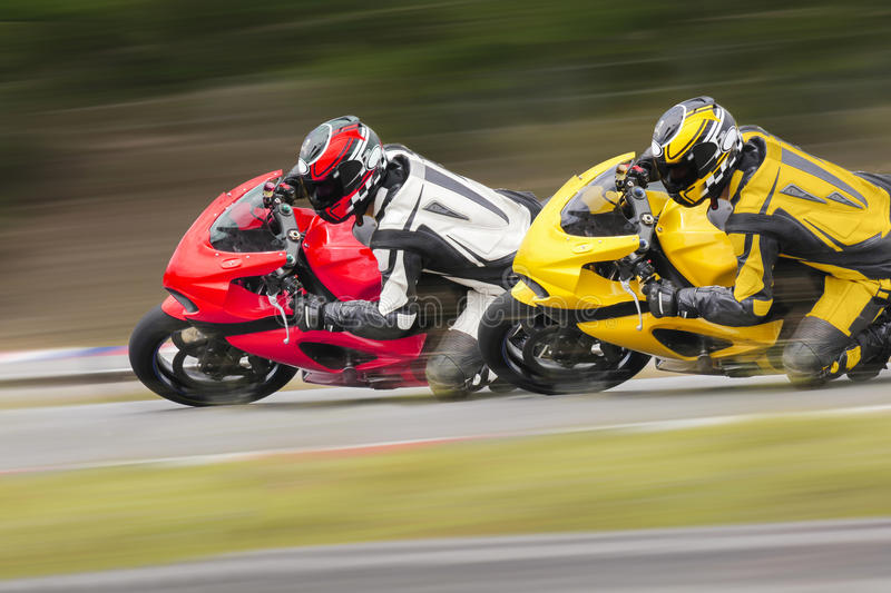 Two motorcycle on track stock photo