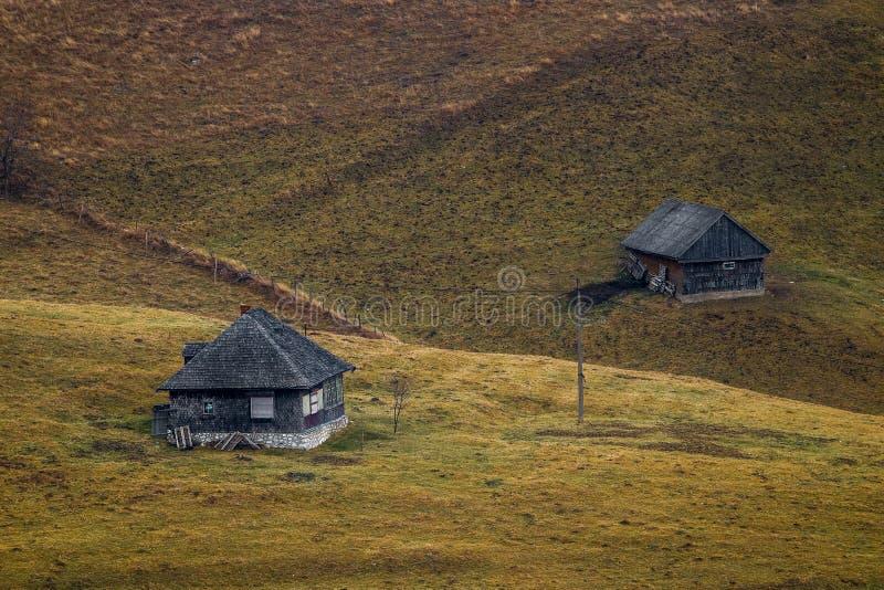 Two mountain barns in Bucegi mountains. Romania stock photos