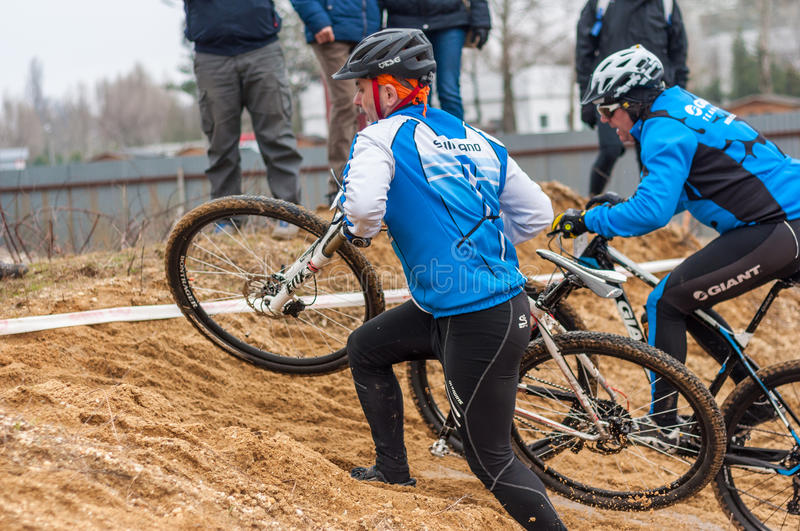 Two mountain bike racers on sand stock photos