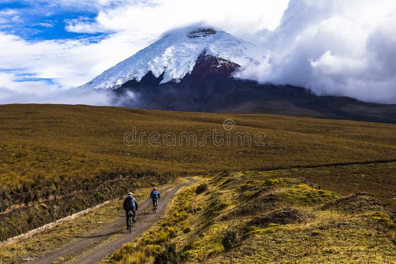 Two mountain bikers riding in the Cotopaxi National Park. Ecuador stock photos