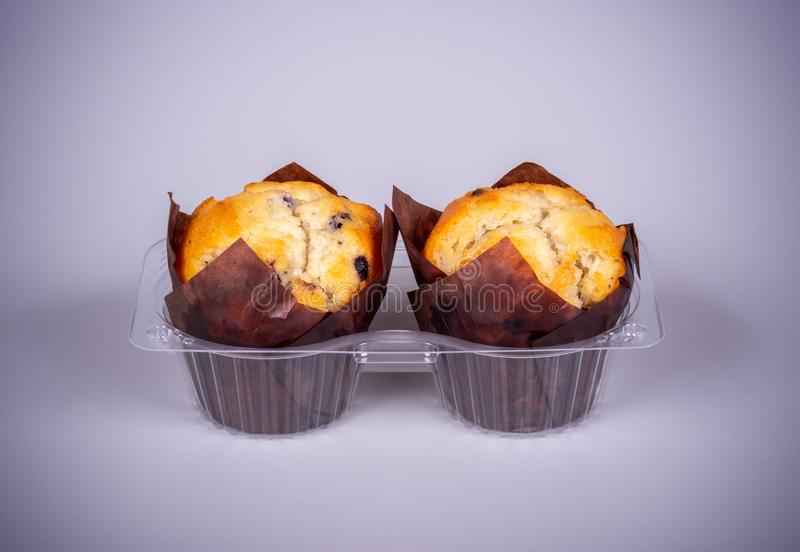 Two muffins in plastic packaging stock photography