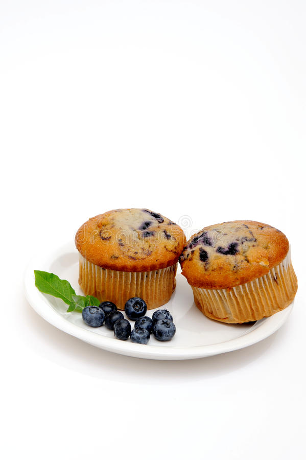Two Muffins On A Saucer Stock Photos