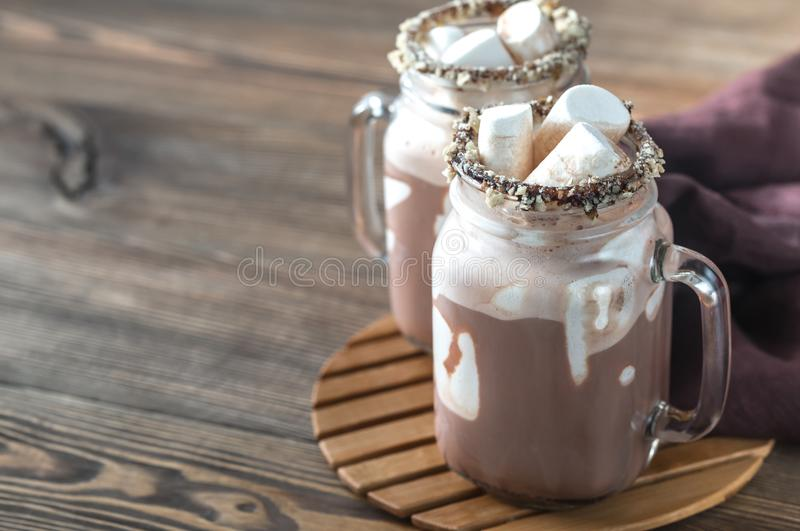 Two mugs of hot chocolate with marshmallows royalty free stock photo