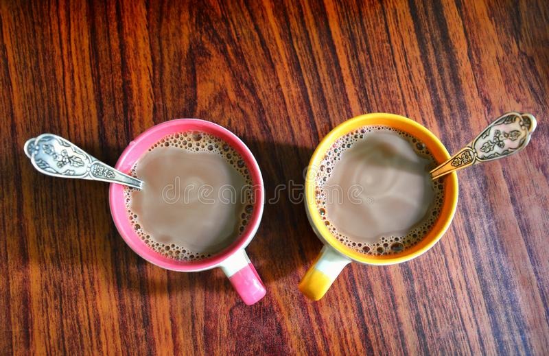 Two mugs of hot cocoa. Breakfast for two. Mugs stand on the wooden surface of the table. View from above. stock photography