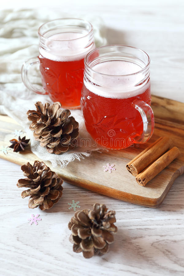 Two mugs of winter craft beer. In New Year decorations royalty free stock images