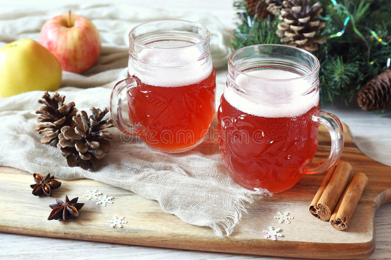 Two mugs of winter craft beer stock image