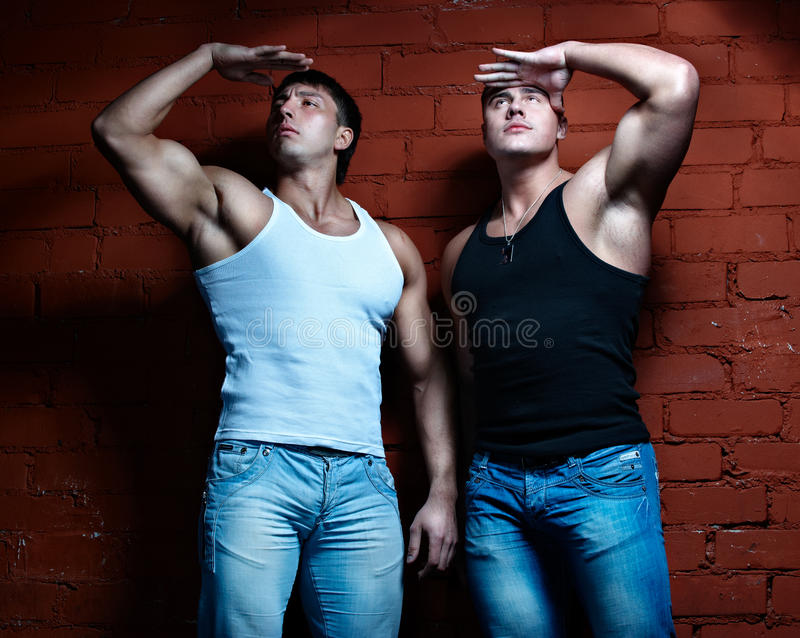 Two muscular guys royalty free stock photo