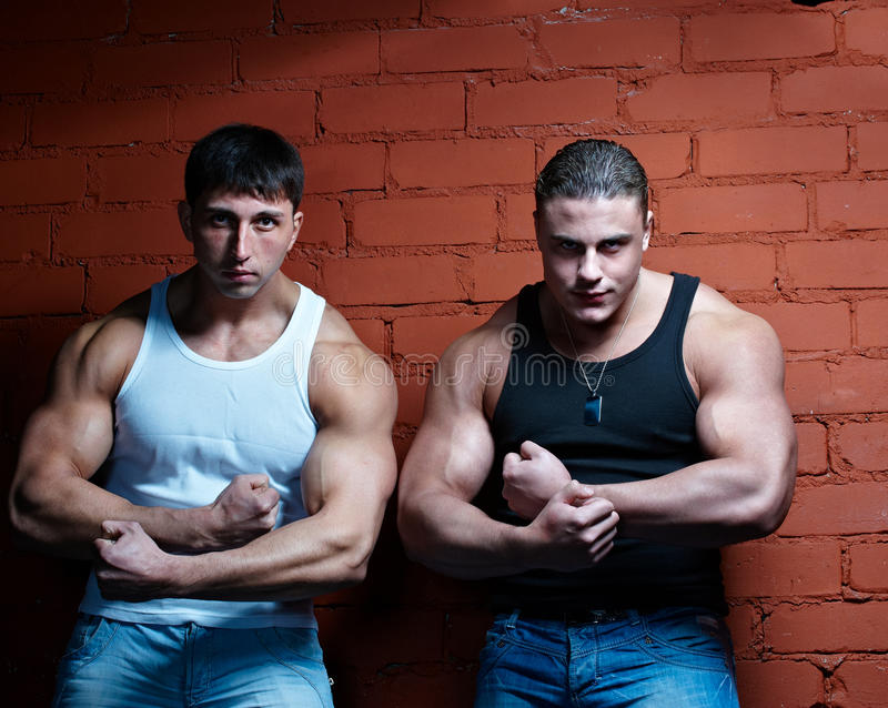 Two muscular guys stock photo