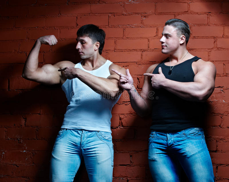 Two muscular guys royalty free stock image