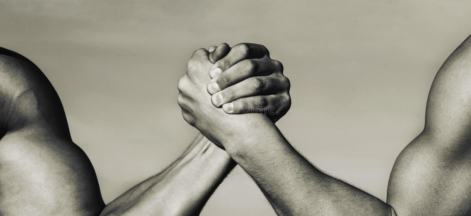 Two muscular hands. Rivalry concept. Hand, rivalry, vs, challenge, strength comparison. Man hand. Two men arm wrestling royalty free stock photo