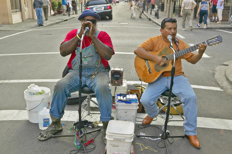 Two musicians perform in street of French Quarter near Bourbon Street in New Orleans, Louisiana stock photography