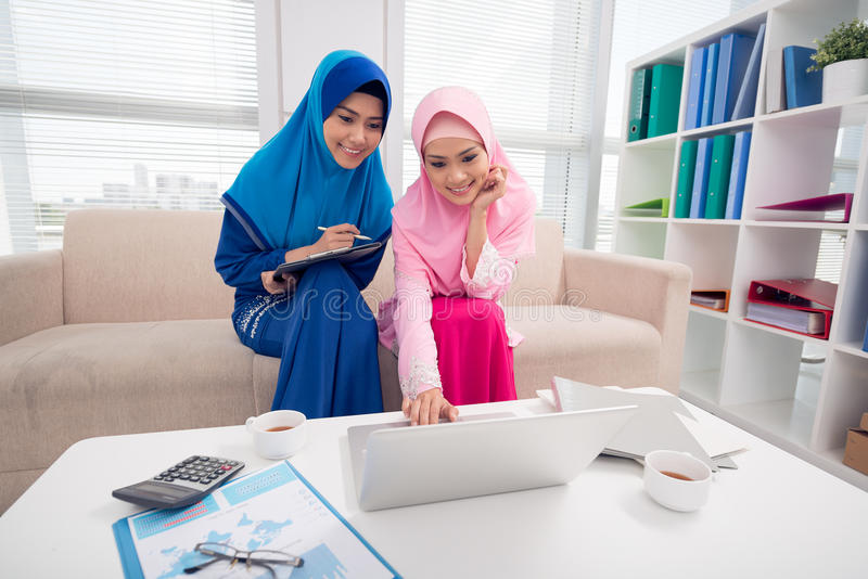 Two Muslim business ladies royalty free stock images